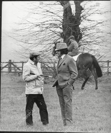 Editorial image of Frankie Vaughan Chats With Racehorse Trainer With Doug Marks At Lambourne Stable Where He Visits His Four Horses