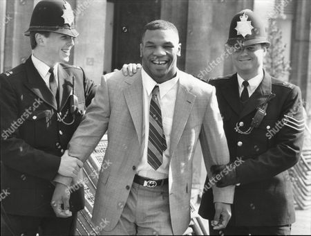 Boxer Mike Tyson With London Policemen Chris Lloyd And James Powell Outside Grosvenor House Hotel After Press Conference