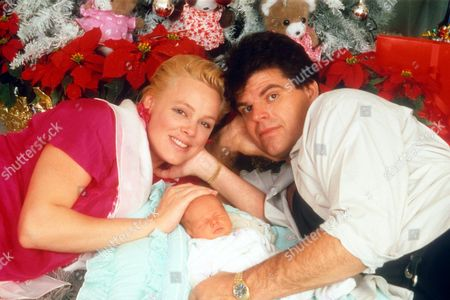 BRIGITTE NIELSEN AND MARK GASTINEAU WITH BABY MARCUS JNR