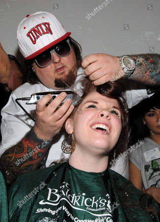 Austin Russell shaves the head of a volunteer
