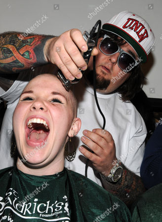 Stock Image of Austin Russell shaves the head of a volunteer