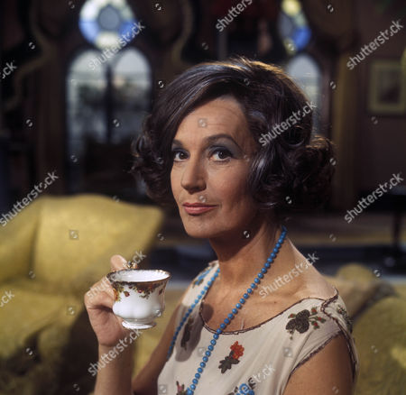 Judy Campbell as Lady Frinton