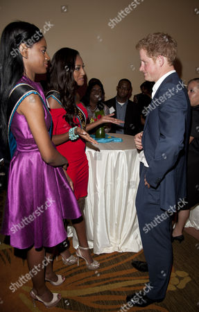 Stock Image of Prince Harry meets Anastagia Pierre (Miss Bahamas - red dress) and Miss World Bahamas