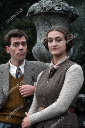 Stock Image of Hugh Laurie as Bertie Wooster and Elizabeth Kettle as Honoria Glossop