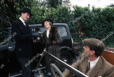 Stock Photo of Stephen Fry as Jeeves, Vivian Pickles as Aunt Dahlia Travers and Hugh Laurie as Bertie Wooster