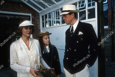 Stock Image of Niamh Cusack as Roberta 'Bobbie' Wickham, Hermione Eyre as Clementina and Hugh Laurie as Bertie Wooster