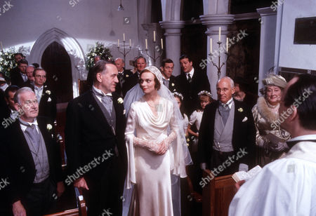 Elizabeth Morton as Madeleine Bassett and John Turner as Roderick Spode. wedding guests in the church to witness their marriage.