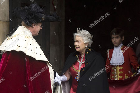 Queen Elizabeth II. Arthur Chatto (son of Lady Sarah and Daniel Chatto) carried her gown