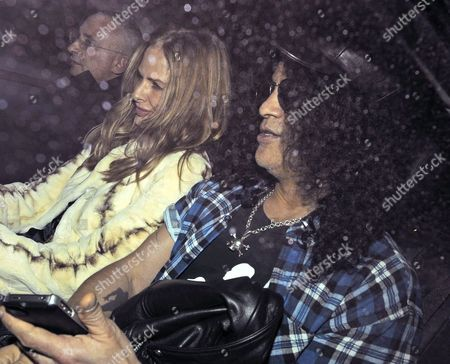 Stock Image of Johnnie Elichaoff, Trinny Woodall and Slash