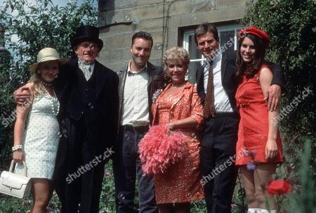 Stock Picture of Movania Parkinson as Gloria, John Bardon as Grandad Rowan, Nick Berry as PC Nick Rowan, Diane Langton as Ruby Rowan, Kim MacDonald as Brian and Lisa Grines Maureen