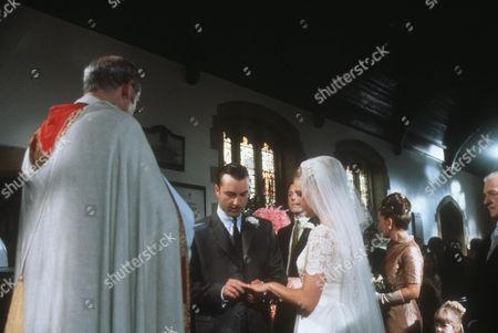 Edwin Newlyn as the vicar, Nick Berry as PC Nick Rowan and Juliette Gruber as Jo Rowan nee Weston