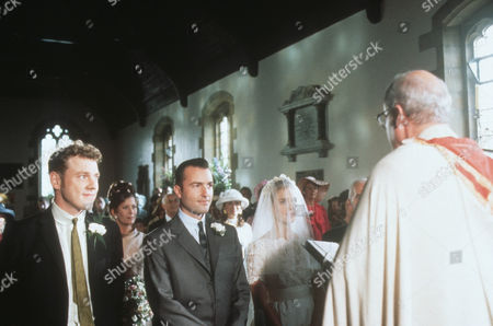 Mark Jordon as PC Phil Bellamy, Nick Berry as PC Nick Rowan, Juliette Gruber as Jo Rowan nee Weston and Edwin Newlyn as the vicar