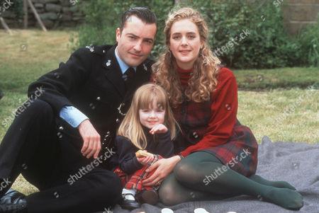 Nick Berry as PC Nick Rowan, Alice Rebecca Jones as Katie Rowan and Juliette Gruber as Jo Weston
