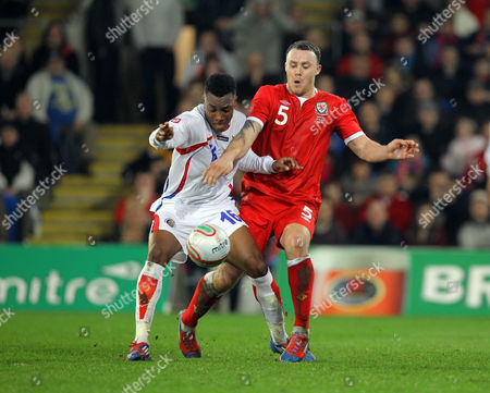 Darcy Blake (R) of Wales challenging Rodney Wallace (L) of Costa Rica