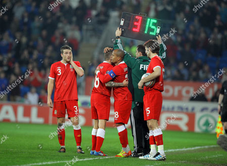 Stock Image of Craig Bellamy of Wales (2nd L) is substituted by Robert Earnshaw (3rd L)
