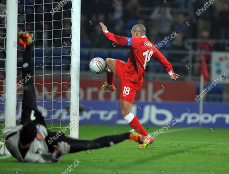 Stock Photo of Robert Earnshaw of Wales (R) kicks the ball in the nets of Keylor Navas goalkeeper for Costa Rica (L) which was disallowed by the match referee