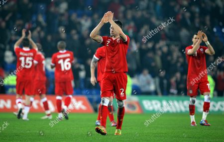 Chris Gunter of Wales thanks supporters at the end of the game