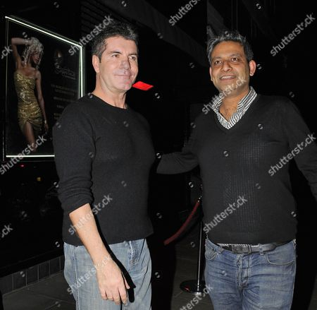 Stock Image of Simon Cowell and Rav Singh
