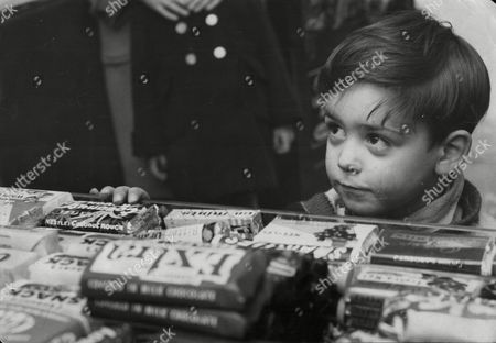 5 Year Old David Garth Buying His Usual Quota Of Sweets At A Shop Near The Elephant And Castle Before The Budget.