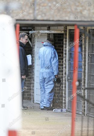 Police forensics officers at Gemma McCluskie's home in Pelter Street, London