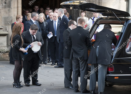 Mia Rathband (daughter) and Ashley Rathband (son) watch the coffin carrying their father leave Newcastle Cathedral
