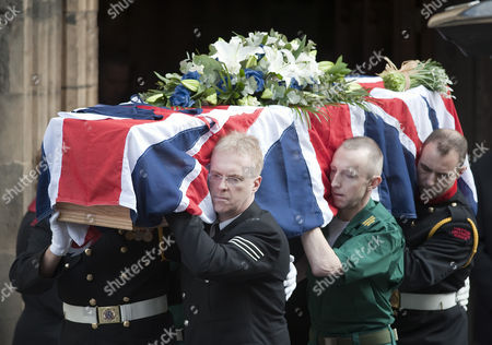 Members of the emergency services carrying the coffin out of Newcastle Cathedral