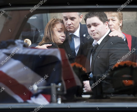 Mia Rathband (daughter) Darren Rathband (brother) and Ashley Rathband (son) watch the coffin leaving Newcastle Cathedral
