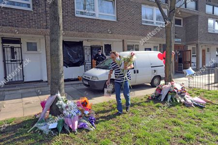 Tributes left to Gemma McCluskie on the Regent's Canal towpath are moved by family friends to outside her flat in Pelter Street, Hackney
