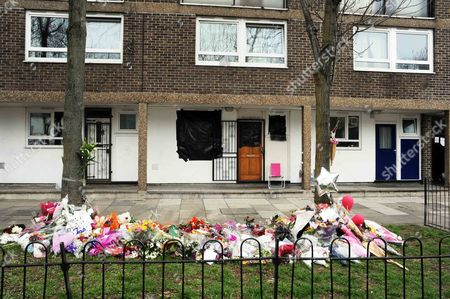 Stock Photo of Tributes left to Gemma McCluskie on the Regent's Canal towpath are moved by family friends to outside her flat in Pelter Street, Hackney