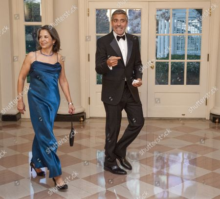 Stock Image of Maria Otero, Undersecretary for Civilian Security, Democracy, and Human Rights at the U.S. State Department arriving at the State Dinner at the White House with George Clooney