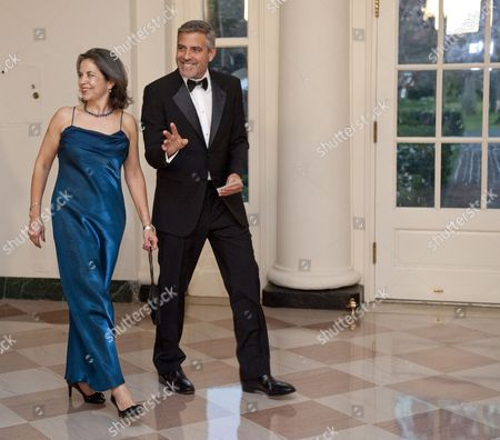 Maria Otero, Undersecretary for Civilian Security, Democracy, and Human Rights at the U.S. State Department arriving at the State Dinner at the White House with George Clooney