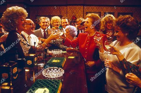 MARGARET THATCHER MAKING A TOAST WITH CAST OF CORONATION STREET IN THE ROVERS RETURN INN DURING TOUR OF GRANADA TELEVISION STUDIOS