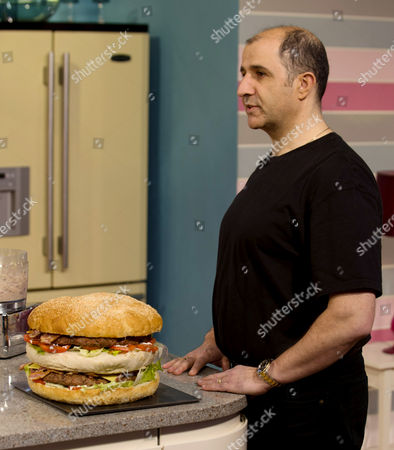 Stock Picture of Vas Herodotou with Britain's Biggest Burger