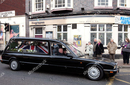 The funeral courtege passes PC Rathband's favoured pub in Stafford, The Grapes, in the town centre