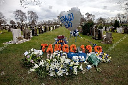 Balloon with 'Tango 190', PC Rathband's call sign, with tributes and flowers left at the funeral of PC David Rathband