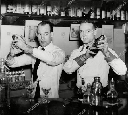 Editorial picture of Two Cocktail Waiters James Simmons And Brother Walter Simmons Employed By English Speaking Union At Charles Street Seen At Olympia Exhibition For Restaurants And Catering Seen Making Cocktails At The Bar