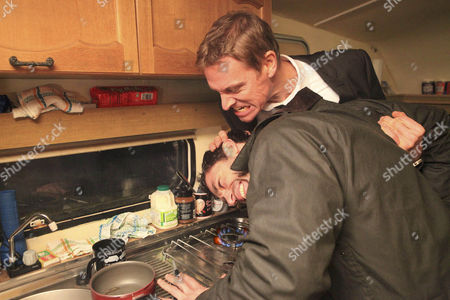 Andy Sugden [Kelvin Fletcher] arrives back at his caravan to find Nick Henshall [Michael McKell] there. Nick grabs him and holds his head near the flame on the cooker.