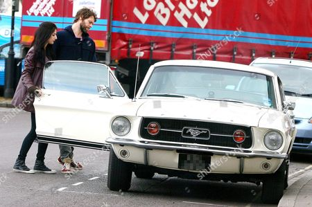 Stock Image of Howard Donald and Katie Halil get into his classic Ford Mustang Gt