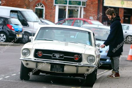 Howard Donald gets into his classic Ford Mustang Gt