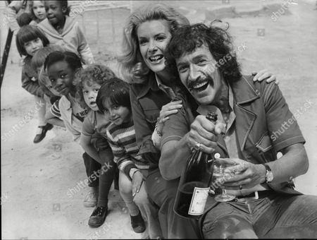 Peter Wyngarde And Sally Ann Howes Actors Share Champagne While Children Line Up Behind Them; They Are Currently Appearing In The King And I 1973.