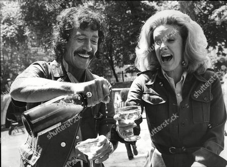 Peter Wyngarde And Sally Ann Howes Actors Share Champagne; They Are Currently Appearing In The King And I 1973.