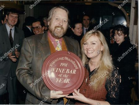 Willie Rushton Comedian Hands Award Plaque To Eve Tomkins Manager Of Burlington's Wine Bar Conduit Street Winners Of The Title Evening Standard's Wine Bar Of The Year 1992.