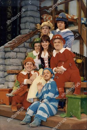 Louise English (snow White) And The Cast Of Dwarves Appearing In Pantomime Snow White And The Seven Dwarfs At The Strand Theatre.