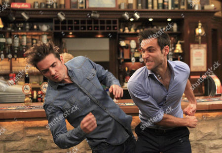 Nikhil Sharma [Rik Makarem] clumsily punches Nicky Pritchard [Matt Milburn] after confronting him about kissing another girl.   Everyone steps in to stop them fighting.