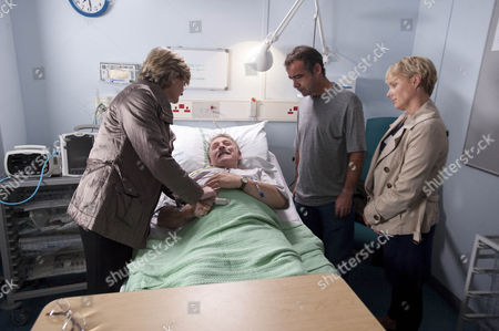 Sally Webster [Sally Dynevor]  is horrified when Kevin Webster [Michael Le Vell] and Pam Hobsworth [Kate Anthony]  argue over Bill Webster [Peter Armitage].