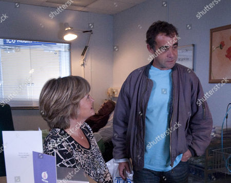 Kevin Webster [Michael Le Vell] and Pam Hobsworth [Kate Anthony] make up.