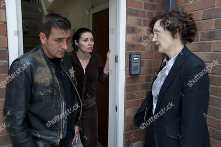 Stock Picture of Dc Malone [Olwen May] arrives at Carla Connor's  [Alison King] and is surprised when Peter Barlow  [Chris Gascoyne] opens the door.  Carla's face drops when DC Malone gives her news about Frank.