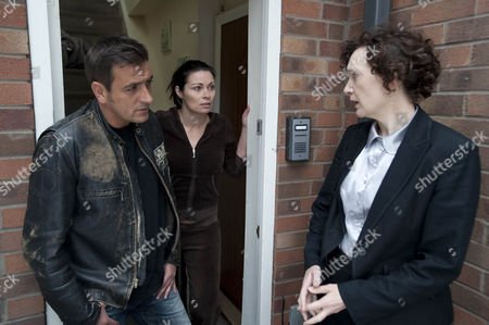 Stock Photo of Dc Malone [Olwen May] arrives at Carla Connor's  [Alison King] and is surprised when Peter Barlow  [Chris Gascoyne] opens the door.  Carla's face drops when DC Malone gives her news about Frank.