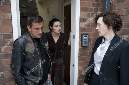 Stock Image of Dc Malone [Olwen May] arrives at Carla Connor's  [Alison King] and is surprised when Peter Barlow  [Chris Gascoyne] opens the door.  Carla's face drops when DC Malone gives her news about Frank.