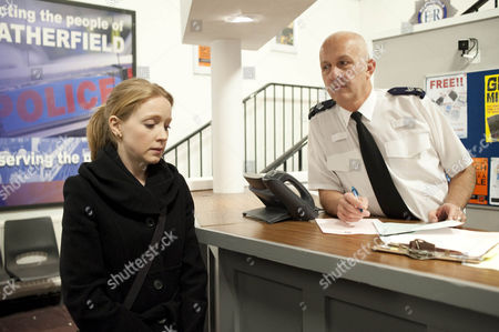 Claire Peacock [Julia Haworth] hands herself in at the police station.